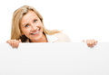 Mature business woman leaning on white banner smiling isolated o Stock Image