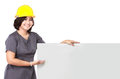 Mature business woman showing blank signboard with hard hat Stock Photo