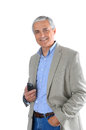 Mature Businessman Holding Cell Phone Stock Photography