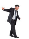 Mature businessman performing a balancing act on white background Stock Photography