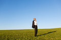 Mature Businessman Standing On Grassy Field Stock Photos