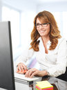 Mature businesswoman modern sitting in the office Stock Images