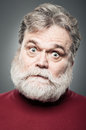 Mature caucasian man crazy face portrait a in his s wide eyed and Stock Photo