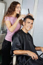 Mature client getting haircut in salon portrait of happy Royalty Free Stock Photo