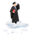 Mature college professor in graduation gown standing on cloud looking with hand over his eyes isolated white background shot Stock Image