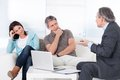 Mature consultant explaining to couple trying explain worried Stock Image