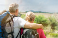 Mature couple with backpack rear view of looking the panorama Stock Photos