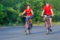 Mature couple on bicycle happy riding a in park Royalty Free Stock Images