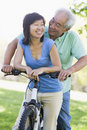 Mature couple bike riding. Stock Photos
