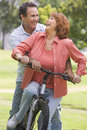 Mature couple bike riding. Stock Images