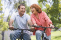 Mature couple bike riding. Stock Image