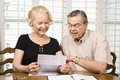 Mature couple with bills. Stock Photo