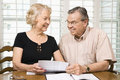 Mature couple with bills. Royalty Free Stock Image