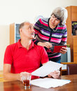 Mature couple calculating family budget at home Royalty Free Stock Photo