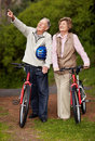 Mature couple with cycle,man pointing at something Stock Photos