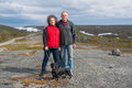Mature couple with dachshund in mountains, Norway