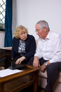 Mature couple while discussing with papers on the table Royalty Free Stock Photography