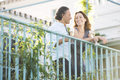 Mature couple drinking champagne leaning hotel s balcony outdoors Stock Image