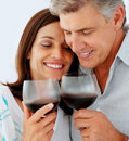 Mature couple drinking a glass of wine together Stock Photo