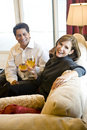 Mature couple drinking wine together on couch Royalty Free Stock Image