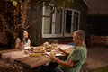 Mature Couple Enjoying Outdoor Meal In Backyard Royalty Free Stock Photo
