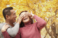 Mature couple enjoying a park in autumn Stock Image