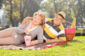 Mature couple enjoying a picnic in the park on sunny day Stock Image