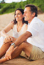 Mature couple enjoying sunset on the beach happy romantic Royalty Free Stock Photos