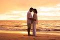 Mature Couple Enjoying Sunset on the Beach Royalty Free Stock Photo