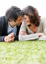 Mature couple enjoying their holidays - on grass Royalty Free Stock Photo