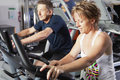 Mature couple at fitness centre Stock Photo