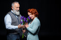 Mature couple with flowers Royalty Free Stock Photo