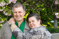 Mature couple happy hug in spring garden Stock Photo
