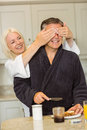 Mature couple having breakfast together at home in the kitchen Stock Photo