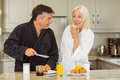 Mature couple having breakfast together at home in the kitchen Stock Image
