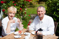 Mature couple having coffee on porch Stock Photo