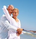 Mature couple having fun at the beach Stock Photography