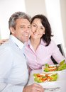 Mature couple having lunch at home Stock Photo