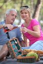 Mature couple having picnic Royalty Free Stock Photo