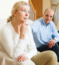 Mature couple having quarrel at home married conflict Royalty Free Stock Image
