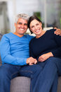 Mature couple home portrait of loving relaxing at Stock Images