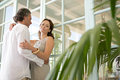 Mature couple hugging at home. Royalty Free Stock Photography