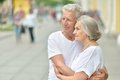 Mature couple hugging portrait of in love outdoors Royalty Free Stock Images
