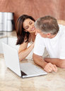 Mature couple with a laptop and looking Royalty Free Stock Image
