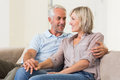 Mature couple looking at each other smiling home Stock Photo
