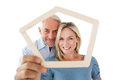 Mature couple looking through frame portrait of happy over white background Royalty Free Stock Photo