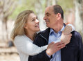 Mature couple in love outdoor happy senior staying with smiles and embracing Stock Photo