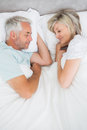 Mature couple lying in bed high angle view of a at home Royalty Free Stock Photo