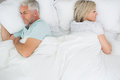 Mature couple lying in bed high angle view of a at home Royalty Free Stock Photography