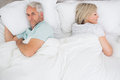 Mature couple lying in bed at home high angle view of a Stock Images